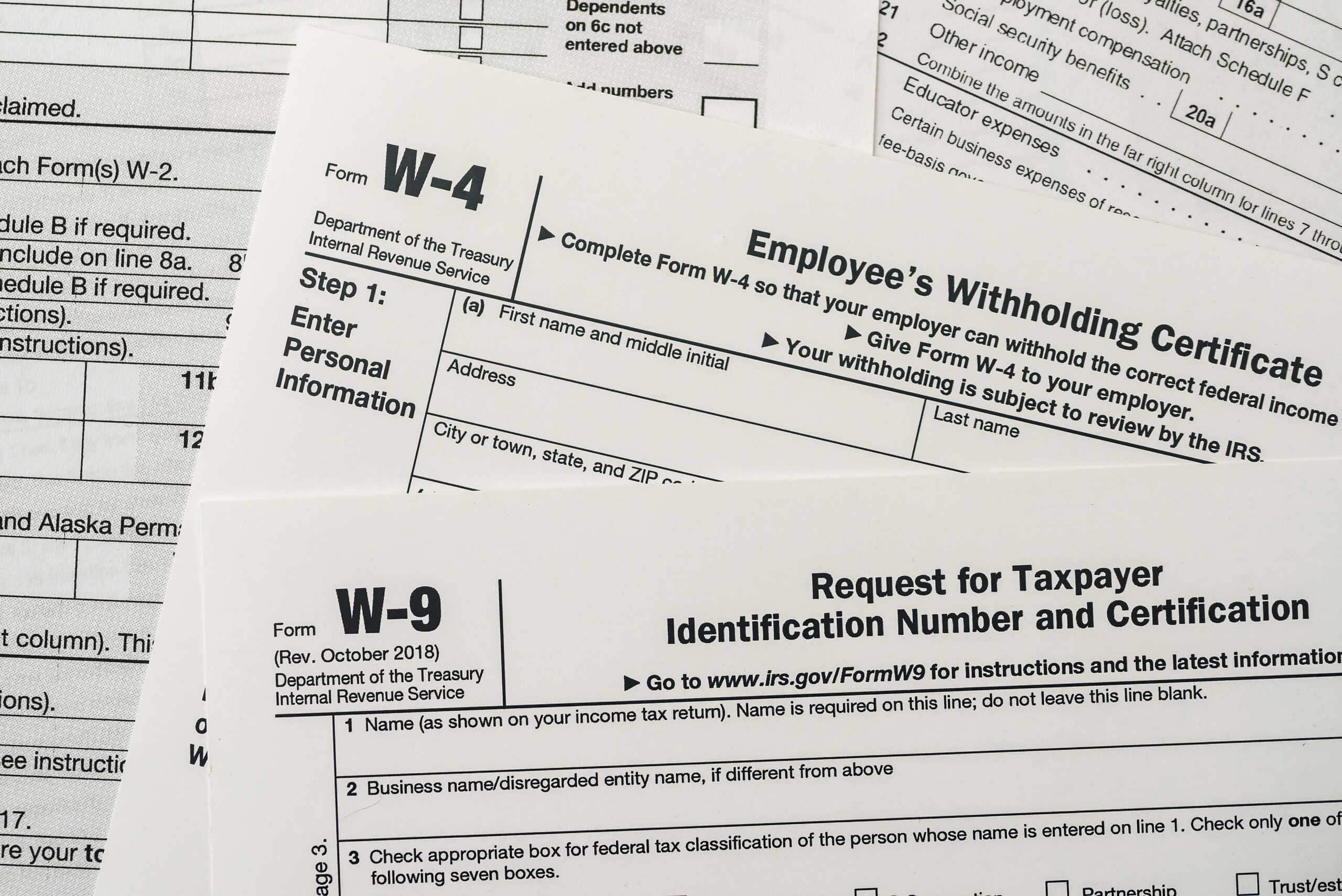 What is the difference between a W-2, W-3, W-4, W-8 and W-9